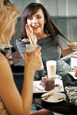 Two women chatting in a coffee shop — Stock Photo