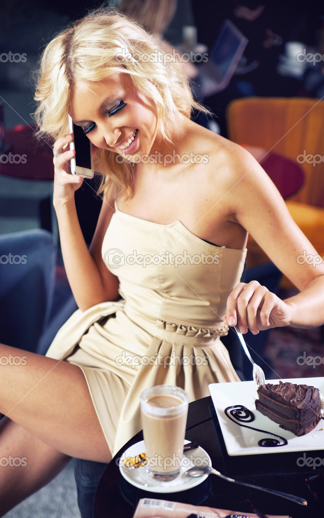 Beautiful girl talking by phone  Stock Photo #10681500