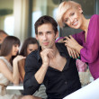 Royalty-Free Stock Photo: Handsome man next to cheerful women