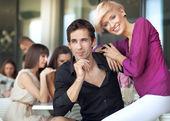 Handsome man next to cheerful women — Stock Photo
