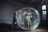 A young lady got stuck in crystal ball — Stock Photo