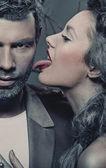 Woman licking man's cheek — Stock Photo