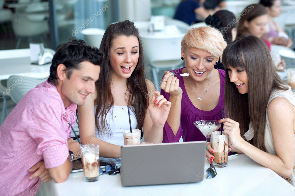 Young browsing internet in a restaurant — Stock Photo #8562289