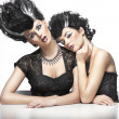 Two sexy women wearning wigs — Stock Photo #9276521