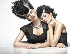Two sexy women wearning wigs — Stock Photo