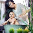 Cute woman cleaning her baby - Stockfoto