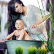 Cute woman cleaning her baby - Stock Photo