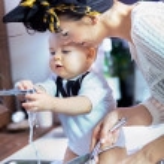 Beautiful baby help with washing — Stock Photo