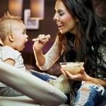 Mum feeding her baby — Stock Photo