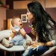 Smiling baby playing with his mum — Stock Photo #9894550