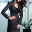 Sexy woman wearing elegant suit — Stock Photo