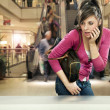 Young woman in shopping center — Stock Photo #9895386