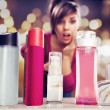 Surprised womlooking at perfumes — Stock Photo #9895423