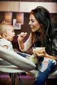 Mum feeding her baby — Stock Photo