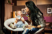 Smiling baby playing with his mum — Foto Stock