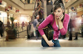Young woman in shopping center — Stock Photo