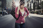 Cute lady speaks by phone on the street — Stock Photo