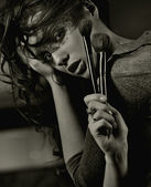 Portrait of a woman with brushes — Stock Photo