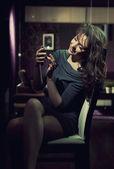 Elegant lady using smartphone — Stock Photo