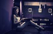 Sexy woman browsing internet late night — Stock Photo