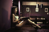 Sexy lady browsing internet late night — Stock Photo