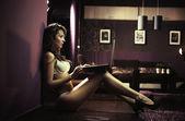 Sexy lady browsing internet late night — Stock Photo