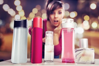 Surprised woman looking at perfumes