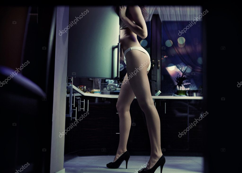 Woman wearing lingerie looking for something in the fridge  Stock Photo #9899918