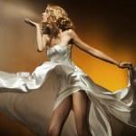 Beautiful woman wearing white dress — Stock Photo