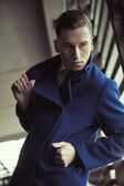 Young man in fashionable coat — Stock Photo