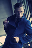 Young man in a fashionable coat — Stock Photo