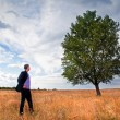 Young businessman and big tree — Stock Photo