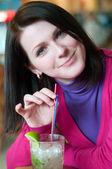Young woman having a mojito — Stock Photo