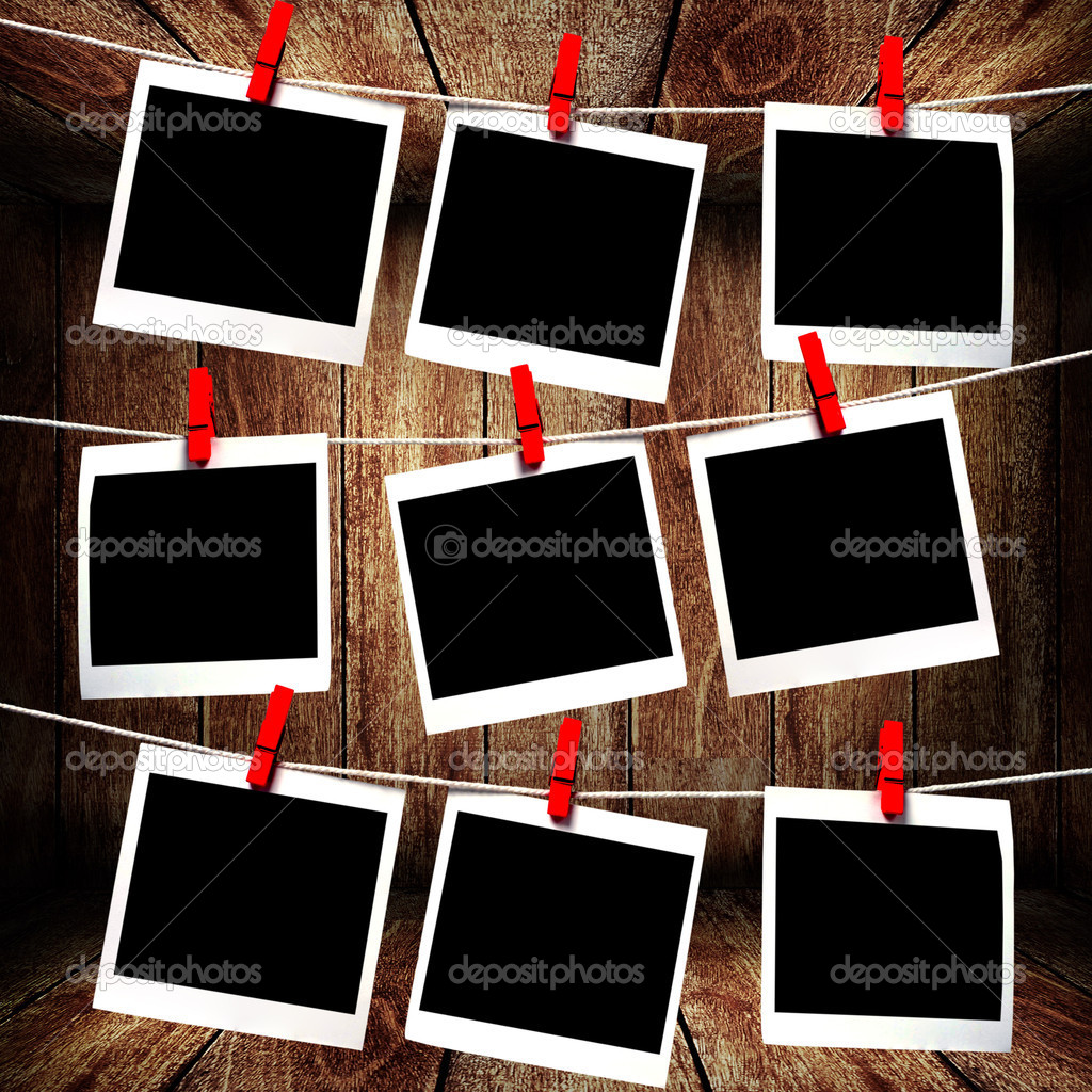 Polaroid frames hanging on rope — Stock Photo © pixbox77 ...