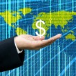 Businessman&#039;s hand hold Dollar with digital wold map background - Stock Photo