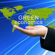 Green economics on businessman's hand — Stock Photo