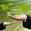 Stock Photo: Businessman's hand share green economics concept