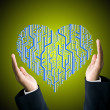 Businessman protect the circuit board in heart shape — Stock Photo