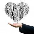 Businessman carry the Circuit board in heart shape — Stock Photo