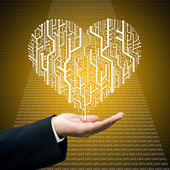 Businessman care the circuit board in heart shape — Stock Photo
