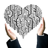Business take care the circuit board in heart shape — Stock Photo
