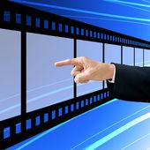 Businessman choose the film — Stock Photo