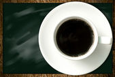 Coffee cup on blackboard background, Coffee shop concept — Stock Photo
