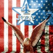 July 4 and eagle statue with American flag - ストック写真