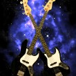 Bass guitar in the universe - Stock Photo