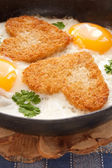 Fried eggs with slices of bread in the shape of a heart — Stock Photo