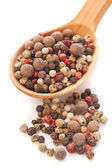 Peppercorns on the wooden spoon — Stock Photo