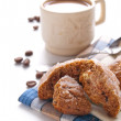 Coffee with milk and cookie — Stock Photo