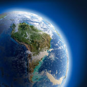 Earth with high relief, illuminated by the sun — Stock Photo