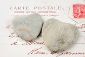 Stone hearts with postcard — Stock Photo